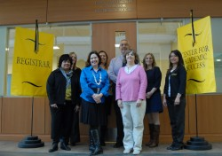 Staff members in the new Center for Academic Success and Records stand outside their offices.