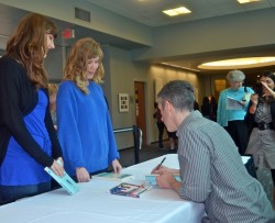 Dan Savage, the author of a popular nationwide sex advice column, signs copies of his books following his talk at the 2013...