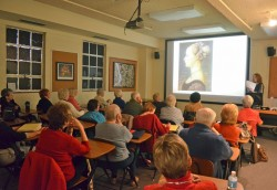 Art history major Avery Centala gives local residents a lecture about DaVinci's female portraiture. (Photo by Erica Grant)