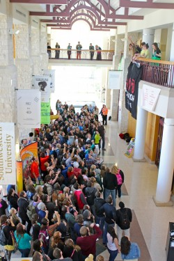 Students gather in the Campus Center to learn the names of the groups that will be performing at the 2013 Clusterfest. (Ph...