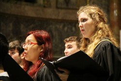 Members of the SU Chorale sing at the Chiesa del Gesu in Rome. (Photo by Star Varner)
