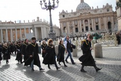 Members of the SU Chorale walk through St. Peter's Square on their way to the Vatican.