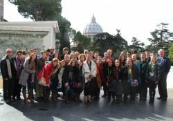 Trip participants pose for a photo in the courtyard of the Vatican Museum. (P)hoto by Star Varner)