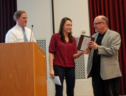 Erica Grant presents the teaching award for a non-tenured faculty member to David Olson, assistant professor of communicat...