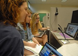 Katy Franklin, Claire Jamison and Ashton Sharp-Lucas discuss with students at Wesleyan University how the different politi...