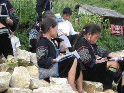 Students from the school in Sapa are shown drawing pictures of the valley in which their town is nestled.