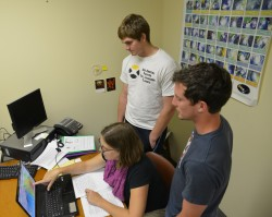 Physics majors Steven Resnik (right) and Ross Warkentin are working on a meteorology-related research project with instruc...