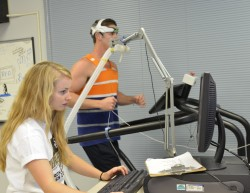 Kinesiology major Emily Ammon is working with professors Scott McLean and Jimmy Smith on a study of both the biomechanical...