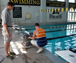 Dylan Johnson, who is a member of the men's swim team, is working with kinesiology professor Scott McLean. McLean has deve...