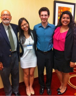 Current Kemper Scholars Phuong-Hieu Nguyen, Robert Lehr and Sabrina Rangel stand with Ryan LaHurd, president and executive...