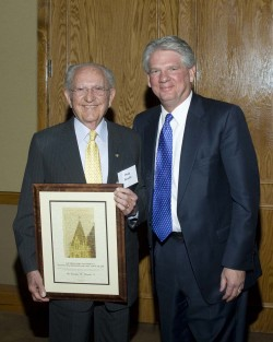 Dr. Doug Benold (left) receives Southwestern's 2009 College Town Award from President Jake B. Schrum