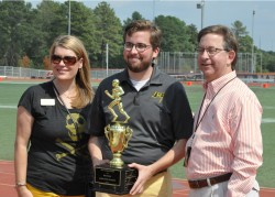 Taylor Kidd, assistant director of gift programs, holds the trophy Southwestern will keep this year for winning the first ...