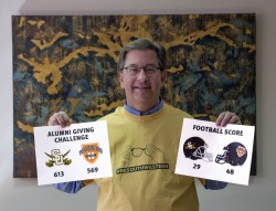 As part of the challenge, the president of the losing college had to pose for a photo wearing a shirt from the other schoo...