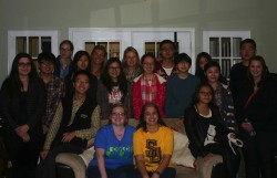 Director of Admission Christing Bowman (front row, yellow shirt) had the students from China over to her house to try thei...