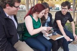 Stephen Holloway, Rebecca Wilson, Elizabeth Bell and Eric Oden plan to build an inexpensive electronic voting device that ...