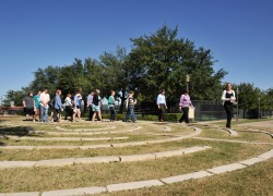 University Chaplain Beverly Jones leads people through the new labyrinth at the Nov. 19 dedication.