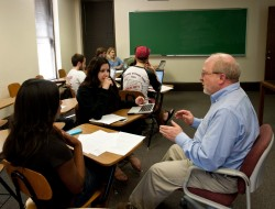 Sociology professor Ed Kain meets with students who are conducting research on how the upcoming changes in the MCAT® will...