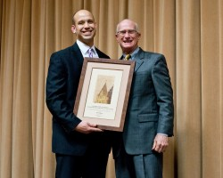 Scott Alarcón (left) was the recipient of the 2014 Martha Diaz Hurtado College Town Award. At right is Rick McKelvey, vic...