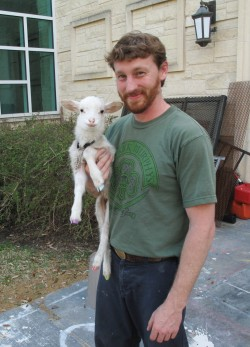 "Justin Smith holds Betty, a lamb he purchased for the spring 2014 production of ""Gypsy."" (Photo of Daniel Dumitru)"