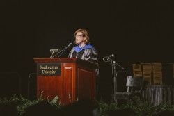 Amanda McMillian speaks to members of the Class of 2014