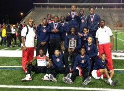 2006 graduate Manjah Fernandez (right) stands with his track team that won the district championship this year. Fernandez ...