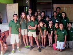 Students at the La Paz Community School in Costa Rica stand with the boxes of refurbished computers that arrived from Sout...