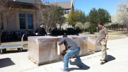Staff members and student workers from Information Technology Services packed the refurbished computers for shipment to Co...