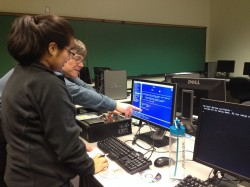 David Williamson from Information Technology Services works with members of the Computer Science Club to refurbish the com...
