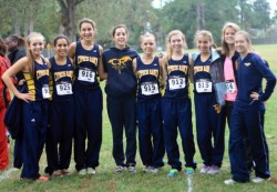 2009 graduate Kristin (Lahaie) Mueller stands with members of the cross-country team she coaches at Cypress Ranch High Sch...