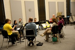 Lois Ferrari (left) and participants in the 2014 Conductors' Institute discuss the philosophy of conducting.
