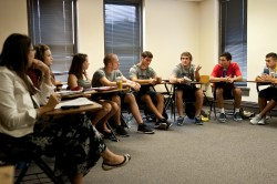 Students in Jessica Hower's First-Year Seminar on pirates discuss Robert Louis Stevenson's classic book about pirates, Tre...