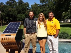 Chandler Johnson, Keeley Coburn and Amir Hessabi stand next to the solar lounge chair they received a patent for.