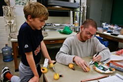 Jesse Barbour and Nate Gruca are testing whether fruits can be used to generate electrical power.