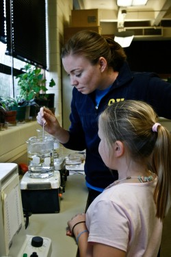 Alana Bergfield and Shelby Strickland are studying how different colors of light affect the ability of plants to make food.