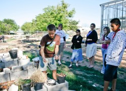 SEAK member Grayson Oheim teaches local middle school students about composting.