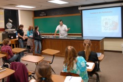 Students in Introduction to Environmental Studies present their class project.