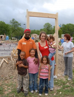 Michael Sedwick and his family stand on the site of their new house.