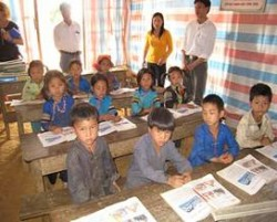 Students in Tong Thouy, Vietnam, currently attend school in this temporary structure.