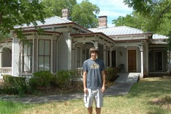 Allen Smith stands in front of the house in Georgetown where his great-grandmother grew up.