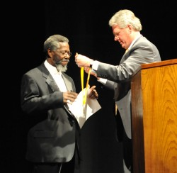 Ernest Clark receives the SU Medal from President Jake B. Schrum