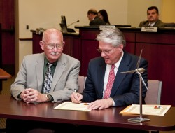 President Jake B. Schrum (right) and Georgetown Mayor George Garver sign the agreement that will enable Southwestern to re...