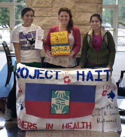 Rotaract members Erin Fonseca, Kristi Lenderman and Mildred Arcovedo collect donations for Partners in Health. (Photo by C...