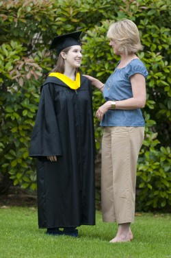 "2010 graduate Sarah Gould models the new ""green"" commencement robes with Xan Koonce, associate director of Unive..."