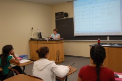 Biology Professor Romi Burks works with students in one of the afternoon seminars.