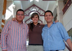 Nancy Juarez (center) will get plenty of support at Southwestern from her older brothers Roberto (left) and Juan (right).