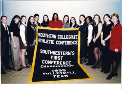 Members of the 1995 volleyball team pose for a photo after winning the SCAC championship.
