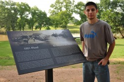 2010 graduate Carlos Barron designed the sign about the 1921 flood that was placed in San Gabriel Park.