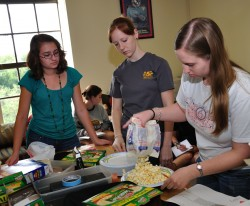 Kira McEntire, Leslie Roberts and  Brooke Blomquist work together on the popcorn and statistics lab (Photo by Carlos Barron).