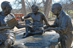 1910 Southwestern graduate J. Frank Dobie (center) is honored in this sculpture located near Barton Springs Pool in Austin...