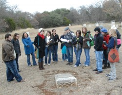 Students in the Texas Slavery class look at the marker in the Old Georgetown Cemetery. The marker says the cemetery contai...